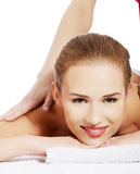 Beautiful caucasian woman lying and relaxing at spa saloon, havi Royalty Free Stock Photo