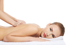 Beautiful caucasian woman lying and relaxing at spa saloon, havi Royalty Free Stock Images