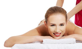 Beautiful caucasian woman lying and relaxing at spa saloon, havi Royalty Free Stock Photos