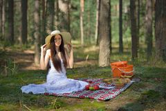 Beautiful caucasian woman at picnic in forest Stock Photo