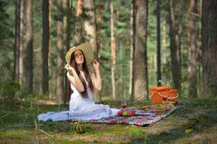 Beautiful caucasian woman at picnic in forest Royalty Free Stock Photography