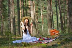 Beautiful caucasian woman at picnic in forest Stock Image