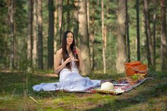 Beautiful caucasian woman at picnic in forest Royalty Free Stock Image