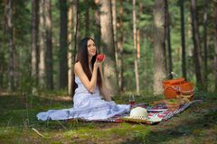 Beautiful caucasian woman at picnic in forest Royalty Free Stock Photo