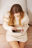 Beautiful caucasian woman playing on tablet. Royalty Free Stock Photo