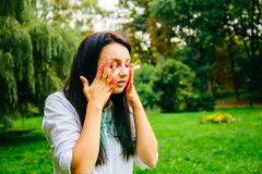 Beautiful caucasian woman plays with holi paints royalty free stock photo