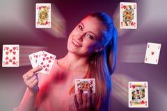 Beautiful caucasian woman with poker cards gambling in casino Stock Photography