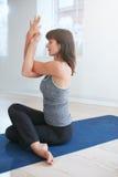 Beautiful caucasian woman practicing yoga - Garudasana Royalty Free Stock Images
