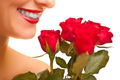 Beautiful caucasian woman with red roses isolated Royalty Free Stock Images