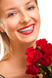 Beautiful caucasian woman with red roses isolated Stock Photos