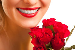 Beautiful caucasian woman with red roses isolated Royalty Free Stock Image