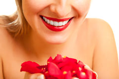 Beautiful caucasian woman with red roses isolated Stock Image