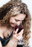 Beautiful caucasian woman with a red wine glass. Royalty Free Stock Images