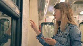 Caucasian Woman Riding In A Subway And Looks At The Map And The Phone Route stock video footage