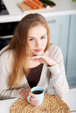 Beautiful caucasian woman is sitting by table with cup of coffee Stock Images