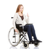 Beautiful caucasian woman sitting on a wheelchair. Isolated on white Stock Photo