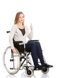 Beautiful caucasian woman sitting on a wheelchair. Royalty Free Stock Photos