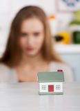 Beautiful caucasian woman and small house model. Stock Image