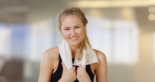 Beautiful caucasian woman smiling in obscure gym office Stock Photos