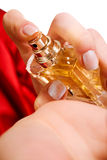 Beautiful caucasian woman spraying perfume Stock Image
