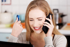 Beautiful caucasian woman talking through phone and working with Stock Images