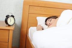 Beautiful Caucasian woman waking up Stock Image