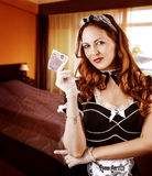 Sexy French Maid  holding money Stock Image