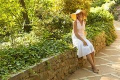 Beautiful caucasian woman in white dress sitting Royalty Free Stock Photo