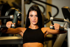 Beautiful caucasian woman working out her arms in fitness Stock Photo
