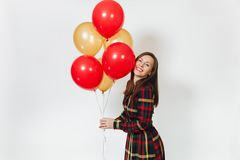 Beautiful caucasian young happy people on white background isolated. Holiday, party concept. Beautiful caucasian young happy woman in long plaid checkered dress Royalty Free Stock Image