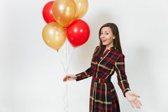 Beautiful caucasian young happy people on white background isolated. Holiday, party concept. Beautiful caucasian young happy woman in long plaid checkered dress Stock Images