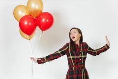 Beautiful caucasian young happy people on white background isolated. Holiday, party concept. Beautiful caucasian young happy woman in long plaid checkered dress Royalty Free Stock Images