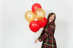 Beautiful caucasian young happy people on white background isolated. Holiday, party concept. Beautiful caucasian young happy woman in long plaid checkered dress Stock Photo