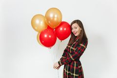 Beautiful caucasian young happy people on white background isolated. Holiday, party concept. Beautiful caucasian young happy woman in long plaid checkered dress Royalty Free Stock Photography