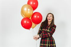 Beautiful caucasian young happy people on white background isolated. Holiday, party concept. Beautiful caucasian young happy woman in long plaid checkered dress Royalty Free Stock Photo
