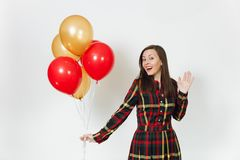 Beautiful caucasian young happy people on white background isolated. Holiday, party concept. Beautiful caucasian young happy woman in long plaid checkered dress Stock Photos