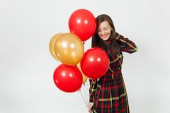 Beautiful caucasian young happy people on white background isolated. Holiday, party concept. Beautiful caucasian young happy woman in long plaid checkered dress Stock Photography