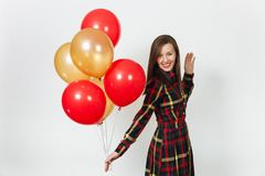 Beautiful caucasian young happy people on white background isolated. Holiday, party concept. Beautiful caucasian young happy woman in long plaid checkered dress Stock Image