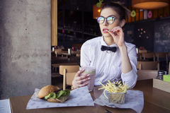 Beautiful caucasian young woman eating lunch fast food fried pot Royalty Free Stock Images