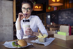 Beautiful caucasian young woman eating lunch fast food fried pot Royalty Free Stock Image