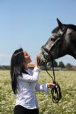Beautiful caucasian young woman and horse portrait Royalty Free Stock Image