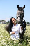 Beautiful caucasian young woman and horse portrait Stock Images