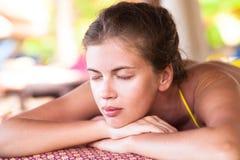Beautiful caucasian young woman lying in spa Stock Photo