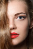 Beautiful caucasian young woman with red lips make Royalty Free Stock Photography