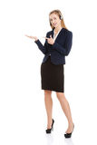 Beautiful causual business woman at call center is pointing on c Royalty Free Stock Image
