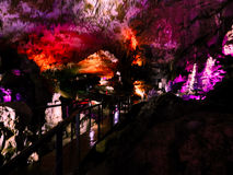 Beautiful cave with colored illumination stock image