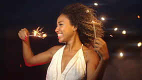 A Beautiful Celebration With Sparkler And Fireworks In The Background At Night In Slow Motion stock video footage