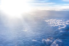 Beautiful celestial landscape with thick light clouds. And bright sun glare royalty free stock images