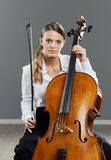 Beautiful cellist. Portrait of a beautiful young woman cellist royalty free stock photo