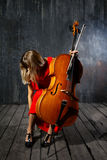 Beautiful cello musician Stock Images
